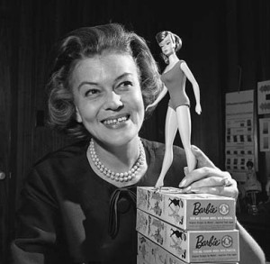 Barbie's first clothing designer Charlotte Johnson posing with 1965 Barbie doll model. May 13, 1964
